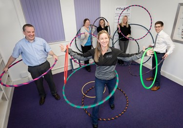 World record-breaking hula hooper building business empire by tacking workplace stress